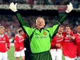 Goalkeeper Peter Schmeichel with his arms aloft after Manchester United win the Champions League in 1999.