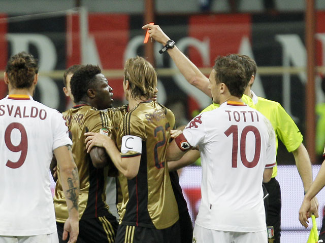 AC Milan midfielder Sulley Muntari reacts after receiving a red card during the Serie A match against Roma on May 12, 2013