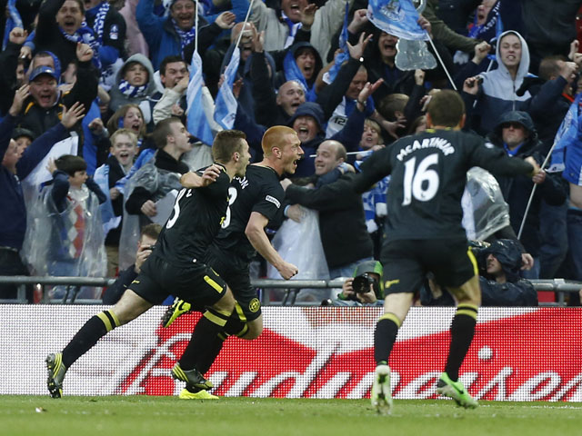 Wigan's Ben Watson celebrates scoring the winning goal in the FA Cup Final on May 11, 2013