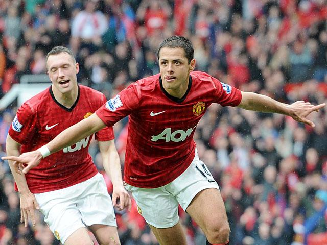 Manchester United's Javier Hernandez celebrates scoring against Swansea on May 12, 2013