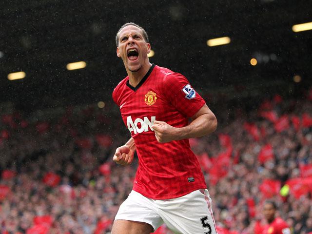 Manchester United defender Rio Ferdinand celebrates scoring against Swansea on May 12, 2013