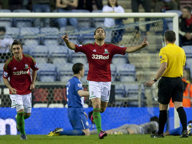 Swansea City's Itay Shechter celebrates scoring against Wigan Athletic on May 7, 2013