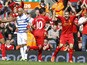 Liverpool's Philippe Coutinho celebrates scoring against QPR on May 19, 2013