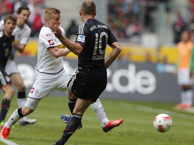 Bayern's Arjen Robben scores the winning goal against Borussia Monchengladbach on May 18, 2013