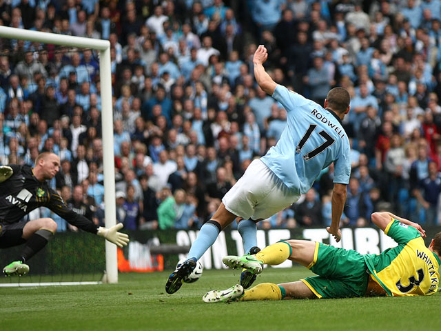 Manchester City's Jack Rodwell scores his second goal against Norwich on May 19, 2013