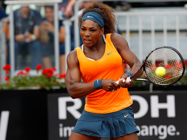 Serena Williams returns the ball to Dominika Cibulkova during their match at the Rome Masters on May 16, 2013