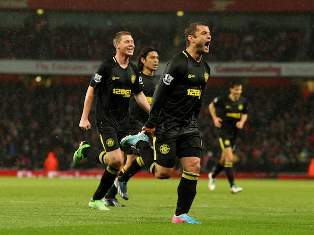 Wigan's Shaun Maloney celebrates an equaliser against Arsenal on May 14, 2013