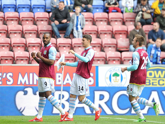 Aston Villa's Darren Bent celebrates scoring against Wigan Athletic on May 19, 2013