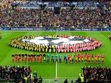 Borussia Dortmund and Bayern Munich players line up prior to kick-off on May 25, 2013
