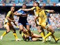 Wakefield Wildcats' Ali Lauitiiti is tackled by Castleford Tigers' Michael Shenton during the Super League match on May 25, 2013