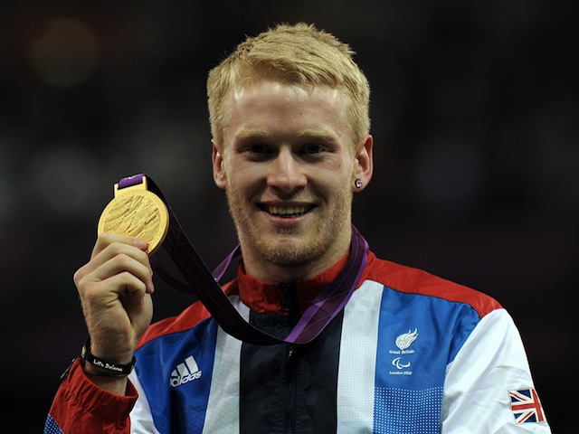 Paralympic athlete Jonnie Peacock celebrates his goal medal in the men's 100m at London 2012 on September 6, 2012