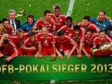 Bayern Munich players and staff celebrate with the cup after winning the German Soccer Cup against Stuttgart on June 1, 2013