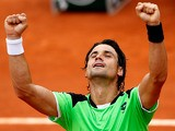 David Ferrer celebrates after defeating Albert Montanes during their second round match of the French Open on May 29, 2013