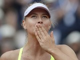 Maria Sharapova blows a kiss to the crowd as she celebrates her defeat over Jie Zheng during their third round match of the French Open on June 1, 2013