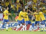 Brazil's Paulo Paulinho is congratulated by team mates after scoring his team's second goal against England during a friendly match on June 2, 2013
