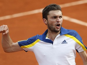Gilles Simon celebrates after defeating Sam Querrey during their third round match of the French Open on May 31, 2013