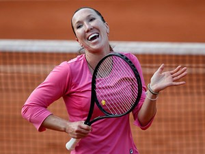Jelena Jankovic celebrates after defeating Samantha Stosur during their third round match of the French Open on June 1, 2013