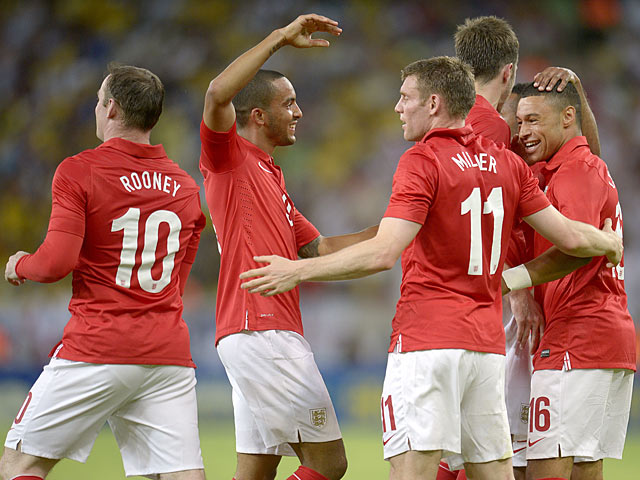 England's Alex Oxlade-Chamberlain is congratulated by team mates after scoring the equaliser against Brazil during a friendly match on June 2, 2013
