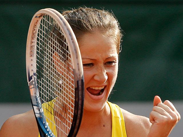 Bojana Jovanovski celebrates after defeating Caroline Wozniacki in their second round match of the French Open on May 29, 2013