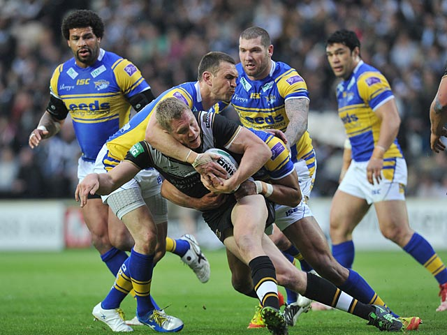 Hull's Chris Green is tackled by Leeds Rhinos' Kevin Sinfield during their Super League match on May 31, 2013