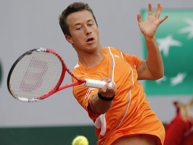 Germany's Philipp Kohlschreiber returns the ball to Czech Republic's Jiri Vesely during their first round match of the French Open tennis tournament on May 28, 2013