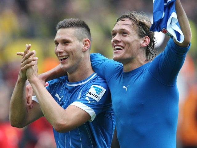 Hoffenheim's Matthieu Delpierre and Jannik Vestergaard of Denmark celebrate after beating Dortmund 2-1 on May 18, 2013