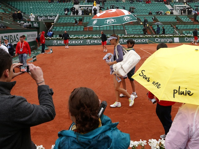 Maria Sharapova leaves the court after another rain delay as she plays Canada's Eugenie Bouchard on May 30, 2013