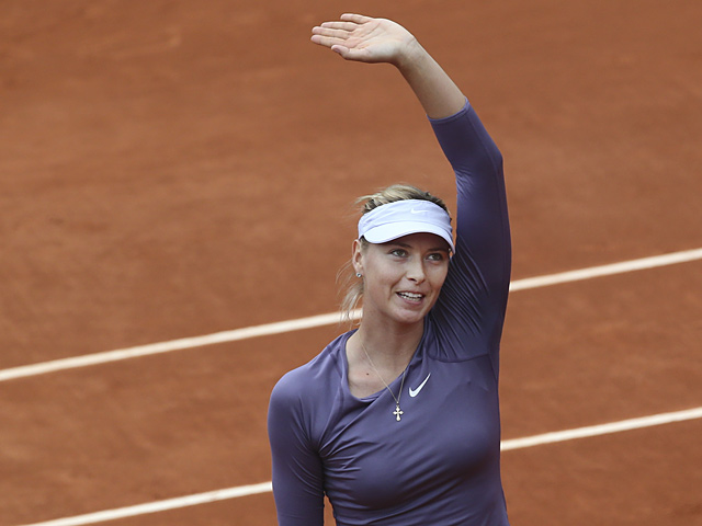 Maria Sharapova celebrates after defeating Eugenie Bouchard during their second round match of the French Open on May 31, 2013