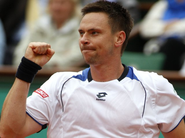 Robin Soderling celebrates winning a point against Roger Federer at the French Open
