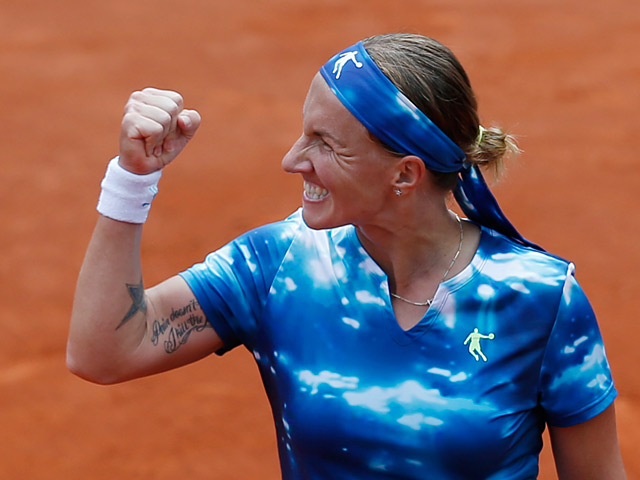 Svetlana Kuznetsova celebrates after defeating Angelique Kerber during their fourth round match of the French Open on June 2, 2013
