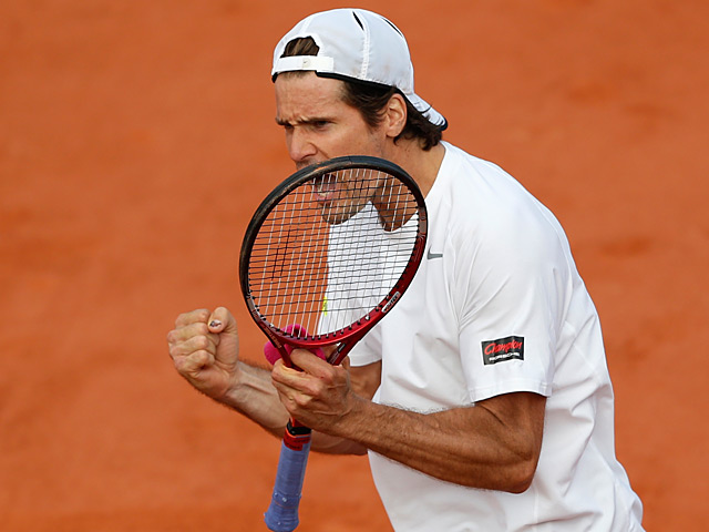 Tommy Haas celebrates after defeating John Isner during their third round match of the French Open on June 1, 2013