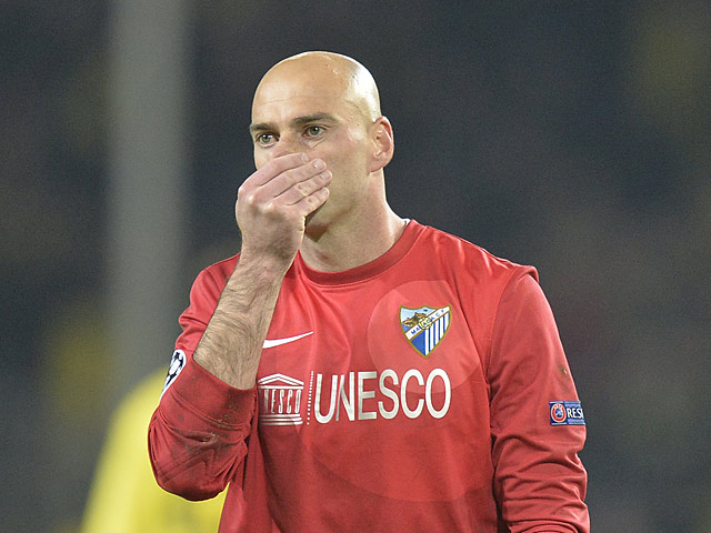 Malaga goalkeeper Willy Caballero reacts at the final whistle on April 9, 2013