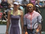 French Open finalists Maria Sharapova and Serena Williams line-up before the match on June 8, 2013