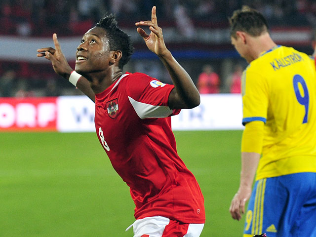 Austria's David Alaba reacts after scoring during the World Cup qualifying match against Sweden on June 7, 2013