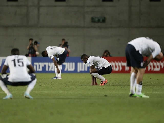 England players stand dejected after defeat to Norway on June 8, 2013