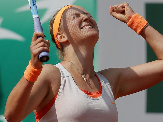Victoria Azarenka celebrates he win over Russia's Maria Kirilenko during their quarterfinal match of the French Open tennis tournament on June 5, 2013