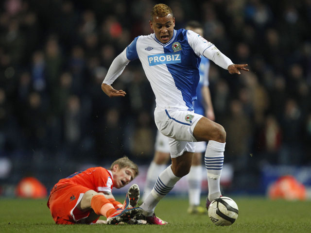 Blackburn Rovers Joshua King gets away from Millwall's Andrew Keogh during the FA Cup Quarter Final Replay on March 13, 2013