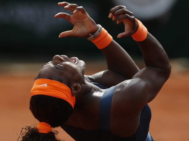 Serena Williams celebrates the final point against Maria Sharapova at the French Open final on June 8, 2013