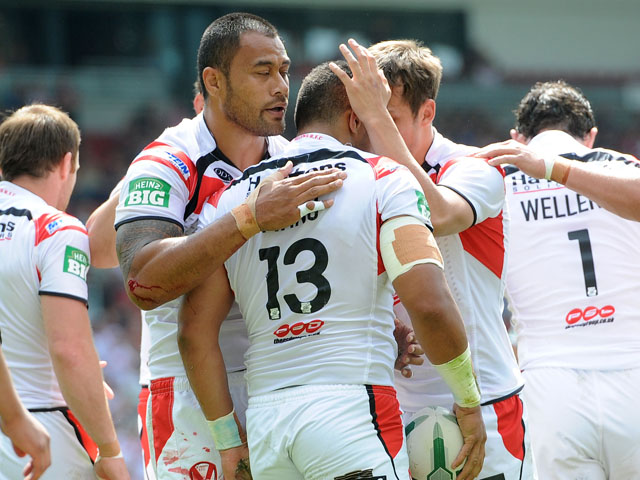 St Helens' Willie Manu is congratulated after scoring a try during the Super League match against the Bradford Bulls on June 9, 2013