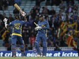 Sri Lanka's Kumar Sangakkara teammate Nuwan Kulasekera celebrate after they defeated England in their ICC Champions Trophy match on June 13, 2013