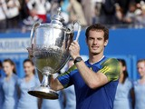 Andy Murray celebrates with the trophy after beating Marin Cilic in the final of the AEGON Championships at The Queen's Club on June 16, 2013