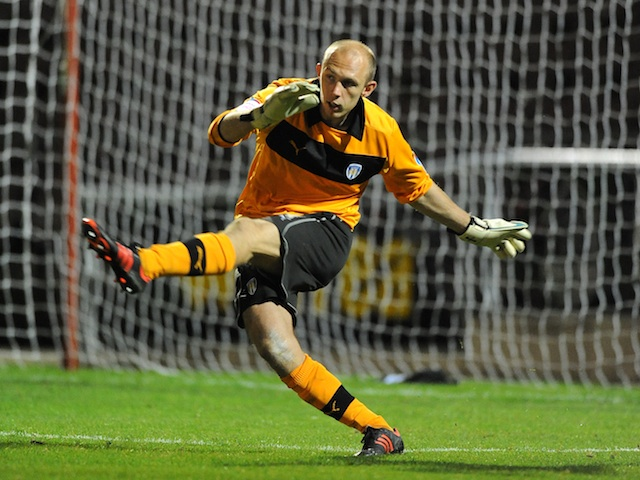 Colchester's Mark Cousins in action against Northampton on October 9, 2012