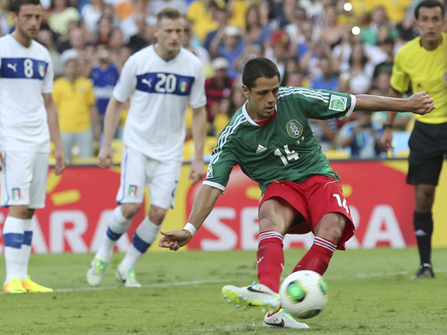 Mexico's Javier Hernandez scores from the penalty spot during the soccer Confederations Cup group A match between Mexico and Italy on June 16, 2013
