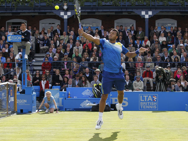 Jo-Wilfried Tsonga of France plays a return to Igor Sijsling of the Netherlands during theirthird round match at the Queen's Club on June 13, 2013