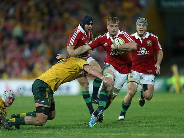 British and Irish Lions' Jamie Heaslip holds off a tackle from Australia's Kane Douglas on June 22, 2013