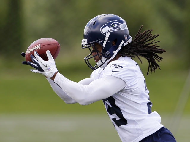 Seattle Seahawks' Earl Thomas catches a ball during an NFL football minicamp on June 12, 2013