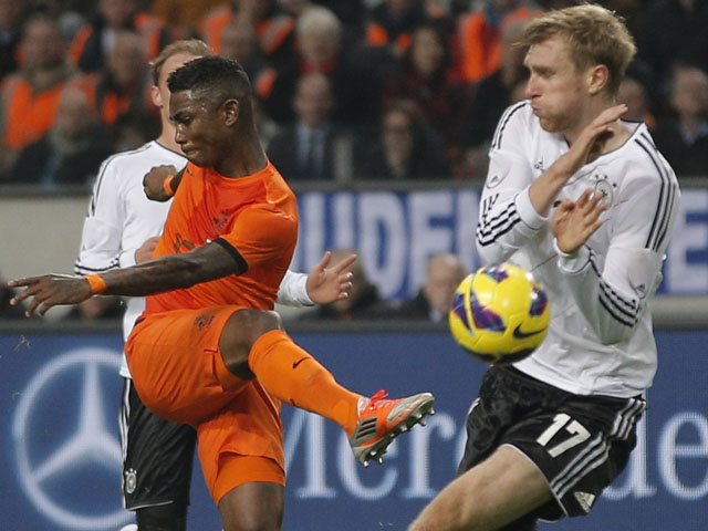 Eljero Elia of The Netherlands has his shot blocked by Germany's Per Mertesacker during the friendly match on November 14, 2012