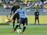 Uruguay's Diego Forlan shoots from the penalty spot but fails to score during the soccer Confederations Cup semifinal match between Brazil and Uruguay on June 26, 2013