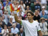 David Ferrer of Spain gestures to the public after defeating Martin Alund of Argentina in their Men's first round singles on June 25, 2013