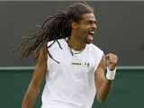 Dustin Brown of Germany reacts after winning a point against Lleyton Hewitt of Australia during their Men's second round singles match on June 26, 2013